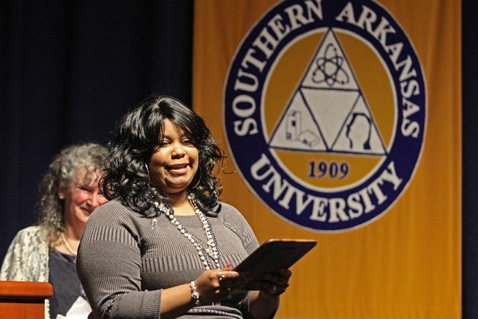 Yolanda Gafford shares a few words after accepting the J.H. Pestalozzi Early Career Award at Southern Arkansas University's Coll_3447827022981710313