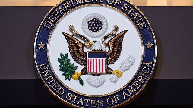 State Department podium logo_1528344318732.jpg_376024_ver1.0_640_360_1551285016763.jpg.jpg